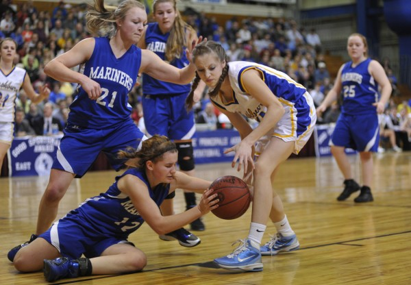 Deer Isle-Stonington's Heidi Brewer (left) and Washburn's Carsyn Koch battle for the ball during last year's Eastern Maine Class D final at the Bangor Auditorium. Washburn won the regional final and went on to capture the state crown. It is the No. 1 seed entering this year's tourney.
