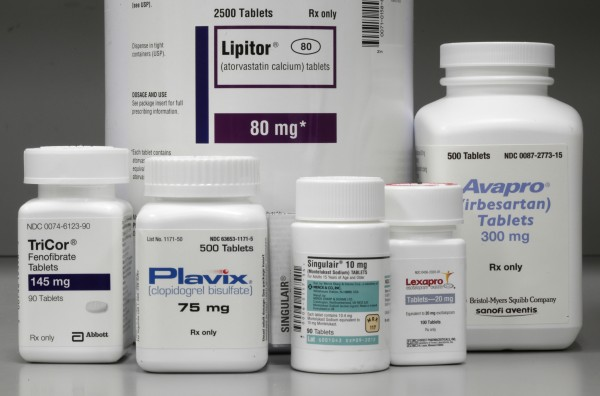 In this June 14, 2011, file photo, bottles of prescription drugs as labeled Lipitor, TriCor, Plavix, Singulair, Lexapro and Avapro are displayed at Medco Health Solutions Inc., in Willingboro, N.J.