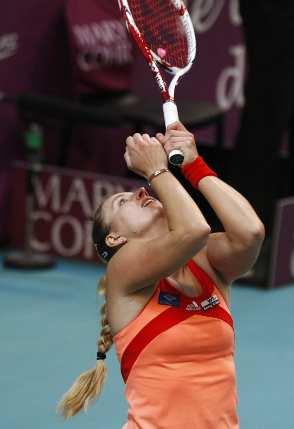 Angelique Kerber of Germany reacts after defeating  Maria Sharapova of Russia in 6-4, 6-4, during their quarterfinal singles match at the GDF Suez WTA Open 2012 tennis tournament at Coubertin stadium in Paris, Friday, Feb. 10, 2012.