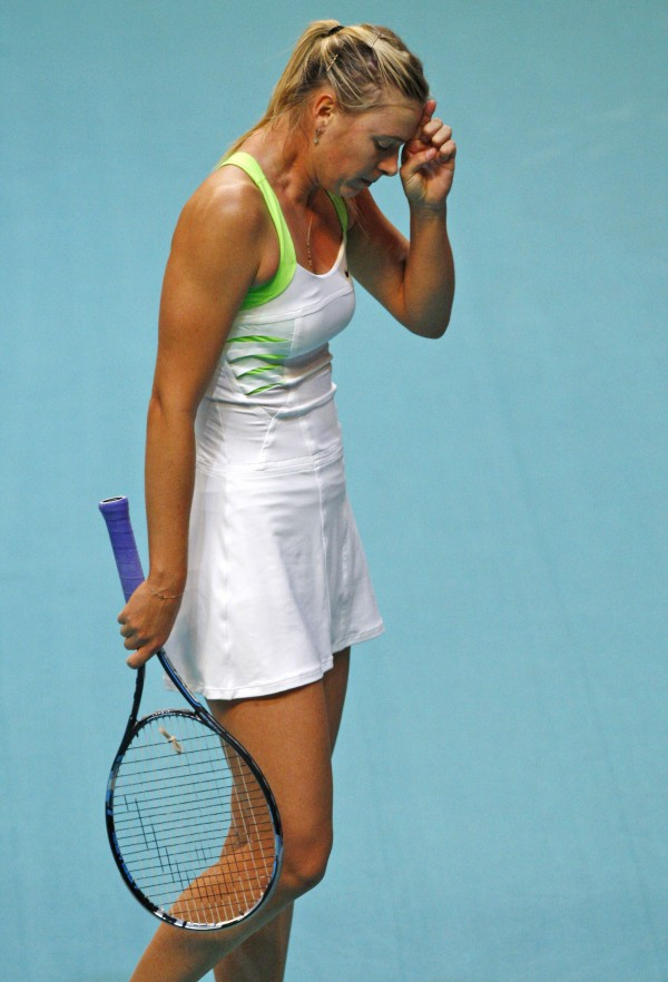 Maria Sharapova of Russia, reacts after losing a point against Angelique Kerber of Germany during their quarterfinal singles match at the GDF Suez WTA Open 2012 tennis tournament at Coubertin stadium in Paris, Friday, Feb. 10, 2012.