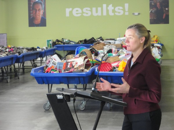 Merritt Carey, of Maine Businesses for Sustainability, lauds Goodwill Industries of Northern New England's new warehouse and outlet store for its reuse and recycling of goods during a Feb. 8, 2012, event at the Gorham location.