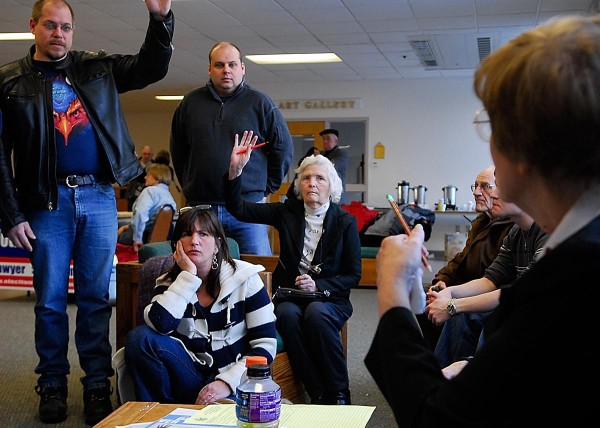 Robin Hall (far left) and Donna Pulver (seated) volunteer to be delegates to the Maine state Republican Convention in 2008 while Penobscot County Republican chairwoman Lois Bloomer of Hermon (right) talks with Hermon Republicans during Maine's GOP Caucus for Penobscot County at Husson College.