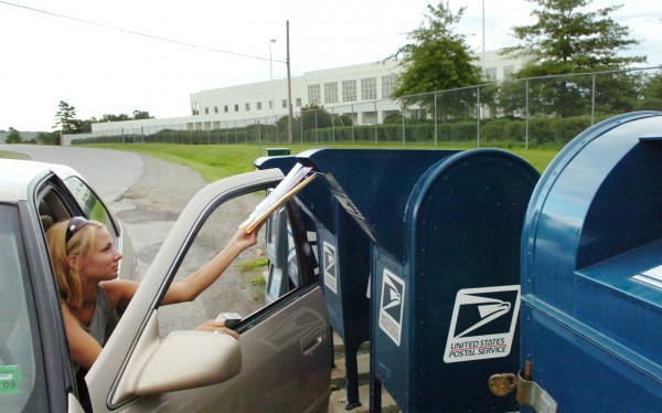Hampden resident Crissy Rowe mails letters outside the U.S. Postal Service Eastern Maine Processing and Distribution Facility in Hampden in 2008.