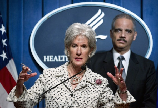 Health and Human Services Secretary Kathleen Sebelius, accompanied by Attorney General Eric Holder, gestures during a news conference announcing the new Health Care Fraud and Abuse Control Program Report, Tuesday, Feb. 14, 2012, at HHS in Washington.