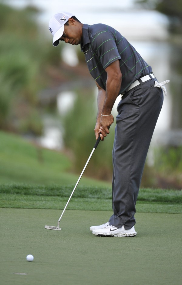Tiger Woods putts on the sixth green during the pro-am event at the Honda Classic golf tournament in Palm Beach Gardens, Fla., on Wednesday, Feb. 29, 2012.