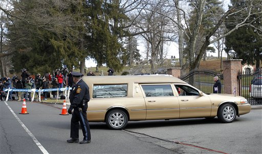 The hearse carrying the body of Whitney Houston arrives at Fairview Cemetery for her burial in Westfield, N.J., Sunday, Feb. 19, 2012.