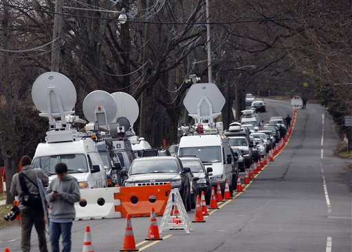 A long line of media vehicles line up to cover the burial of Whitney Houston at Fairview Cemetery for her burial in Westfield, N.J., Sunday, Feb. 19, 2012.