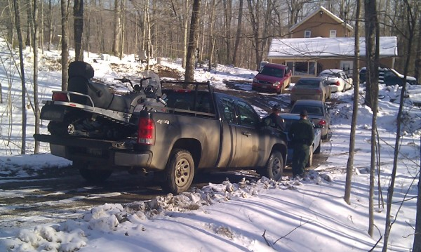 A truck driven by a Maine Game Warden with a snowmobile in the bed pulled into the driveway of the Jackson home where police believe Jerry Perdomo was last seen. The truck was accompanied by a Maine State Police cruiser on Tuesday, Feb. 28, 2012.