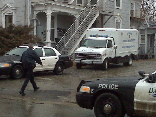 Bangor police Sgt. Paul Edwards heads into the Court Street building where a suspicious death was reported Wednesday night, Feb. 22, 2012.