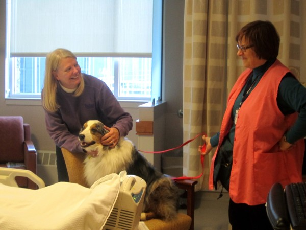 Corinne and Darby say hello to Elaine, who is visiting her sick mother at Eastern Maine Medical Center.