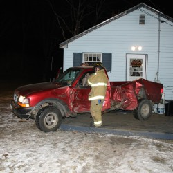 Driver burned in pickup crash