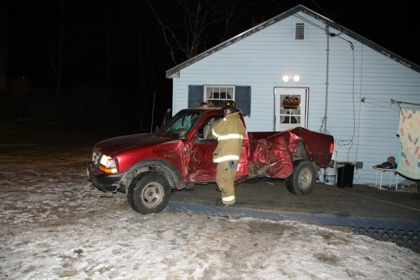 Lt. Dennis Camber inspects a truck after Rockland Fire and EMS responded to a &quotvehicle into a house&quot call on Sunday.