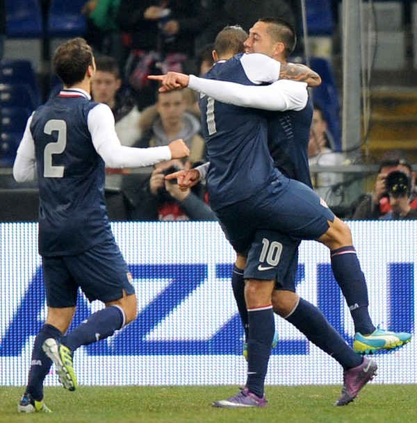 U.S. midfielder Clint Dempsey (right) celebrates with teammates after scoring during a friendly soccer match between Italy and USA, at the Genoa Luigi Ferraris stadium in Italy, Wednesday, Feb. 29, 2012. U.S. won 1-0.
