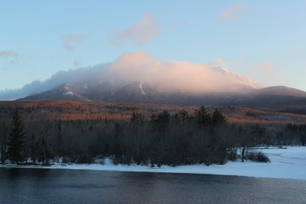 Mount Katahdin glows in the sunrise as seen from Abol Bridge on the Golden Road near Baxter State Park on Feb. 19.