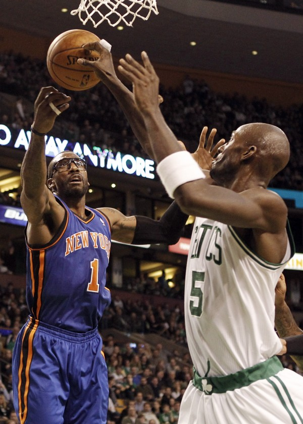Boston Celtics' Kevin Garnett (5) and New York Knicks' Amare Stoudemire (1) go for a rebound during the second half of Boston's 91-89 win in Boston on Friday, Feb. 3, 2012.