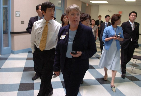 Joyce Hedlund, center, seen here leading delegates from South Korea through Eastern Maine Community College, will retire after a 43-year in education that includes 25 years in Maine's community college system.