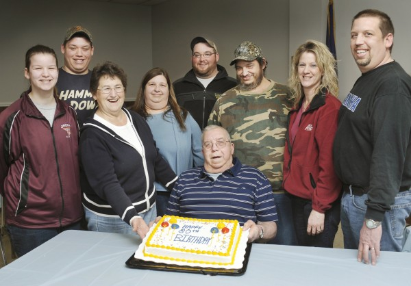 Sumner Edward Pinkham (seated) was born on Feb. 29, 1932, a Leap Year. 2012 makes him 20 years old or actually 80, as the clock turns. Celebrating with him were (from left) granddaughter Tiffani, grandson Tyler, wife Marion, daughter Brenda, grandson Tony Loring, son Tom, daughter-in-law Missy and son Ed at the Glenburn town hall Sunday, Feb. 26, 2012.