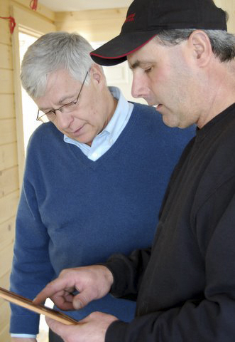 David Pottle (right) explains the layout of his new indoor lobster storage facility in Eastport to U.S. Rep. Mike Michaud, who visited Lighthouse Lobster and Bait on Wednesday, Feb. 22, 2012.