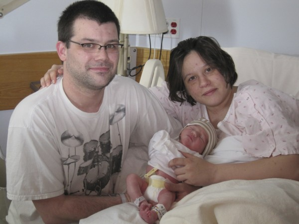 Casey Danforth and Michael Robinson Jr., both 31-year-olds from Glenburn, hold their newborn son, Alexander Ryan Robinson, on Wednesday at Eastern Maine Medical Center. Alexander was the first baby born at the Bangor hospital on Leap Day Wednesday, Feb. 29, 2012.