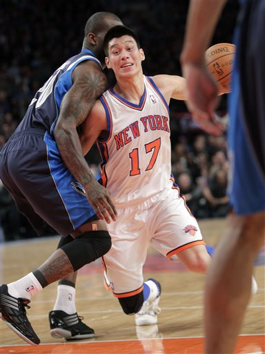 New York Knicks' Jeremy Lin (17) tries to move past Dallas Mavericks' Dominique Jones during the first half of an NBA basketball game in New York, Sunday, Feb. 19, 2012.