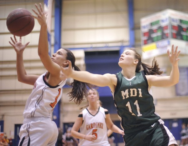 Gardiner Tiger girls basketball player Jenna Moore (14) steals a pass intended for MDI girls player Abby Jewett (11) in the second half of their Class B basketball playoff game at the Bangor Auditorium, Saturday, Feb. 18, 2012.