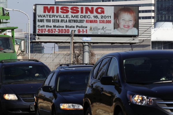 Cars pass an electronic billboard with an image of missing Maine toddler Ayla Reynolds, Tuesday, Feb. 7, 2012, in Philadelphia. A New Hampshire-based group is putting up billboards to spread the word about the missing toddler from Waterville who was 20 months old when she was reported missing on Dec. 17.
