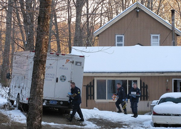 Maine State Police look over a residence in Jackson on Sunday, Feb. 26, 2012, where police believe Jerry Perdomo was last seen before his disappearance on Feb. 16, 2012.