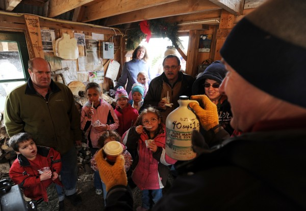 Len Price (right) gives a short lecture on how syrup is made at his Nutkin Knoll Farm sugar shack in Newburgh in March 2010.
