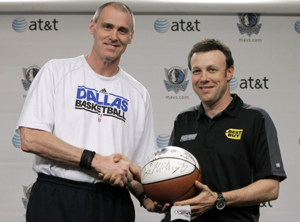 Matt Kenseth (right), who won the NASCAR Daytona 500 auto race early Tuesday, shakes hands with Dallas Mavericks hcoach Rick Carlisle after Carlisle presented Kenseth with a team-autographed basketball before an NBA basketball game between the Mavericks and the New Jersey Nets on Tuesday, Feb. 28, 2012, in Dallas.