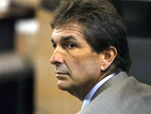 In a July 21, 2010 photo, John Goodman, accused of running a stop sign in his Bentley convertible and killing 23-year-old Scott Patrick Wilson, appears in court in West Palm Beach, Fla. Goodman, 48, recently adopted his 42-year-old girlfriend. Critics say he is trying to maintain some indirect control over money he fears could be awarded to the family of Wilson. Goodman goes on trial next month in that death, accused of drunken driving manslaughter.