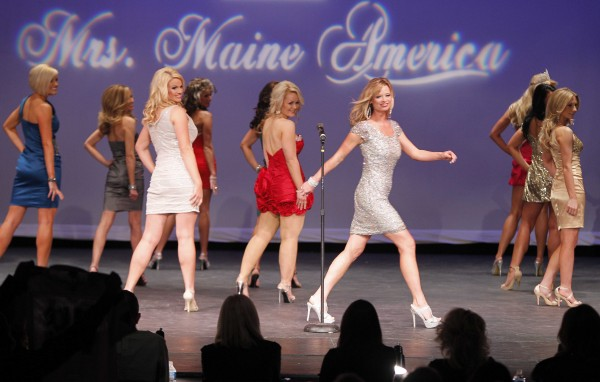 Mrs. Gorham Destiny Cook (silver dress) struts across the stage during the Mrs. Maine-America Pageant Sunday, Feb. 5, 2011, in Saco, Maine.