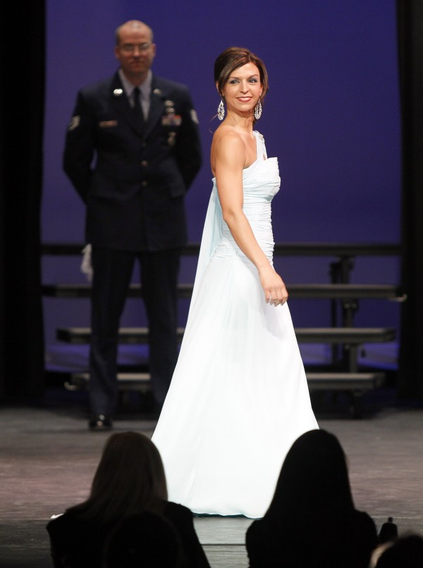 Mrs. Saco Carrie Johnson competes in the evening gown competition as her husband, Michael, looks on at the Mrs. Maine-America Pageant, Sunday, Feb. 5, 2011, in Saco, Maine. Johnson was third runner-up