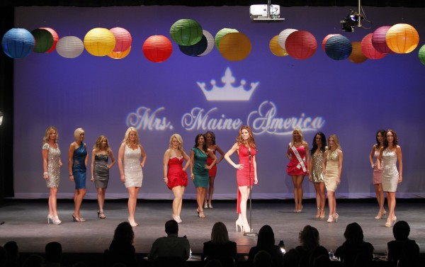 The 13 contestants in the Mrs. Maine-America Pageant are introduced Sunday, Feb. 5, 2011, in Saco, Maine. Mrs. Springvale Cassandra Provencher stands in the foreground in red dress.