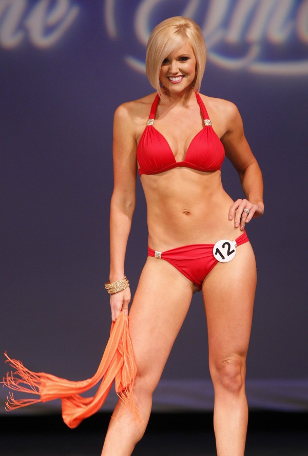 Mrs. Cumberland County Ashley Tucci competes in the swimsuit competition during the Mrs. Maine-America Pageant, Sunday, Feb. 5, 2011, in Saco, Maine. Tucci was runner-up.