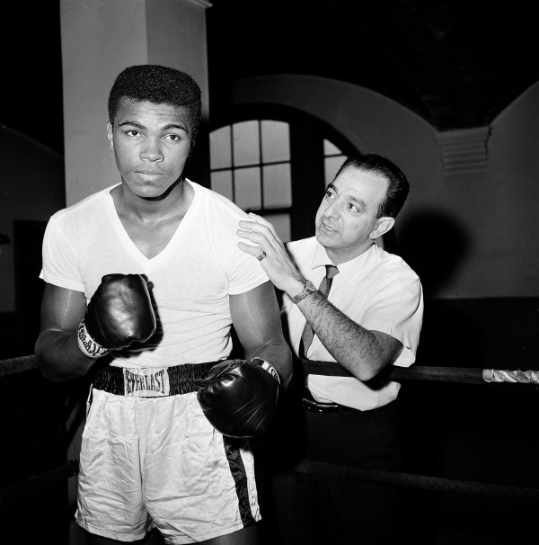 In this Feb. 8, 1962 file photo, a young Muhammad Ali is seen with his trainer Angelo Dundee at City Parks Gym in New York.