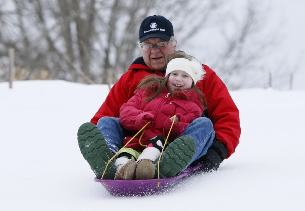 Alannah Shevenell, 9, rides on a sled with her grandfather, Jamie Skolas, at their home in Hollis on Thursday, Feb. 2, 2012. Alannah returned home Wednesday afternoon, three months after receiving six new organs in a groundbreaking operation. Hospital officials say it was the first known esophageal transplant in the world and the largest number of organs transplanted into a person at one time in New England.