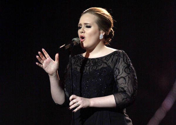 Adele performs on stage during the Brit Awards 2011, at The O2 Arena in London in February 2011. Adele, who had surgery on her vocal cords last year, will perform at the Grammys on Feb. 12, 2012. She is also nominated for six awards.