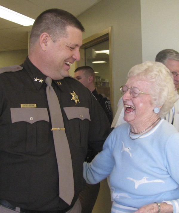 Waldo County Sheriff Scott Story shares a laugh with 90-year-old Doris Herbert of Morrill. Herbert worked as a deputy matron at Waldo County Jail beginning in the 1970s and came to the open house for the new sheriff's office in order to hand in her badge. &quotIt was a great experience, and I loved every minute of it,&quot she said.