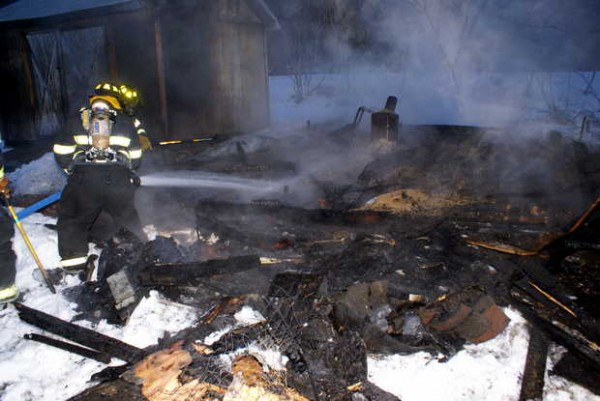 Oxford firefighters extinguish the remains of a chicken coop fire just after 6 a.m. Thursday at 54 Mechanic Falls Road in Oxford.