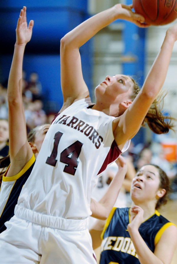 Nokomis' Marissa Shaw (14), looks for two points during first-half action of the girls class B quarterfinals at Bangor Auditorium.