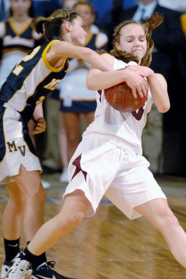 Medomak Valley's Alanna Vose (32) struggles for the basketball against Kelsie Richards (23) for Nokomis High during second half action of the Class B Girls quarterfinal at Bangor auditorium.