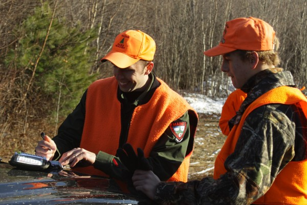 Warden Jonathan Parker interacting with a hunter during filming of &quotNorth Woods Law&quot during deer season. The Animal Planet TV show that focuses on the Maine Warden Service debuts March 16.
