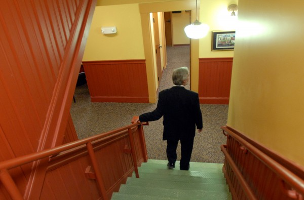 Kenneth Schmidt, CEO of Penobscot Community Health Care, walks down a set of stairs in the renovated 1903 school building that has become the home of the Helen Hunt Health Center in Old Town.  Schmidt was giving a tour of the most recent renovations of new pharmacy, pediatric, and walk-in care facilities.