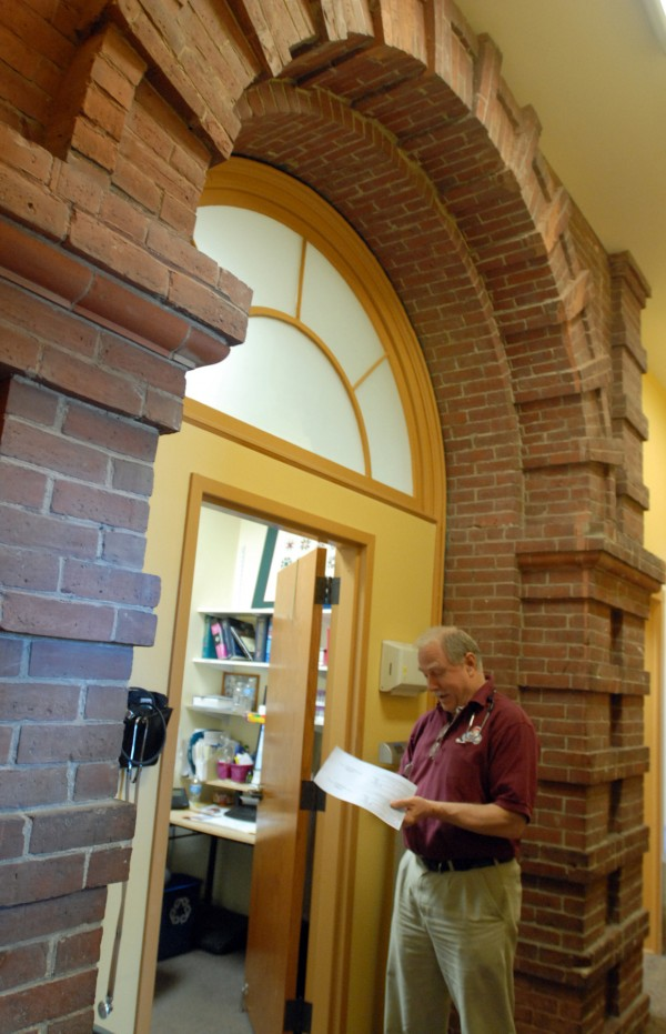 Dr. Chris Ritter stands outside of his office, which is through the boys entrance of the original 1903 school building. The Helen Hunt Health Center in Old Town has just completed more renovations of new pharmacy, pediatric, and walk-in care facilities. Approximately 9,000 people use Helen Hunt for their comprehensive health care needs.