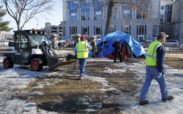 Police and city workers move in to clear out the Occupy Maine encampment  during a peaceful eviction from Lincoln Park, Friday, Feb. 10, 2012, in Portland, Maine.