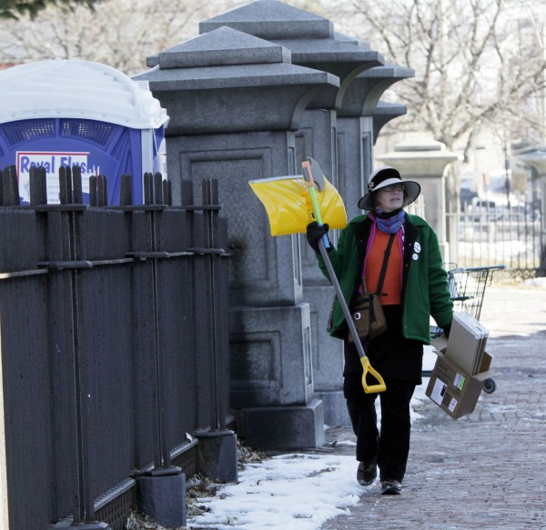 Heather Curtis of Portland, Maine, removes items as she dismantles part of the Occupy Maine encampment in Lincoln Park in Portland, Maine, on Monday, Feb. 6, 2012.
