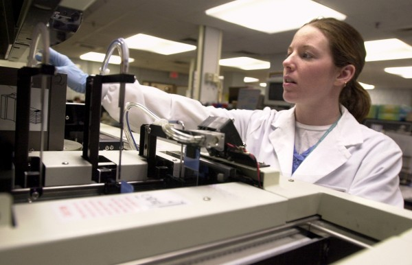 Jennifer Carney operates the Sysmex machine that prepares blood smears at the NorDx lab at Maine Medical Center in Portland in February 2003.