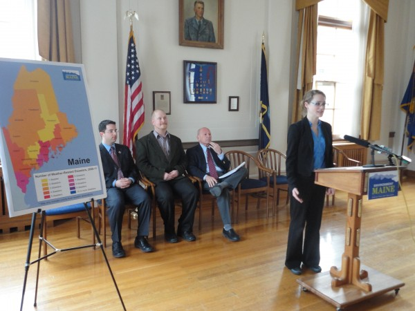 Anika James, a field associate for Environment Maine, announces the release of a report titled &quotIn the Path of the Storm: Global Warming, Extreme Weather, and the Impacts of Weather-Related Disasters in the United States&quot Wednesday morning at Portland City Hall. Seated behind her are Red Cross Emergency Services Director Michael Mason, City Councilor David Marshall and Portland Mayor Michael Brennan.