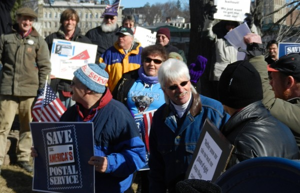 Postal workers and others gather near the post office in downtown Bangor on Monday, Feb. 20, 2012 for a Presidents' Day rally urging Congress to act quickly in ending the prefunding mandate that is affecting United States Postal Service finances.