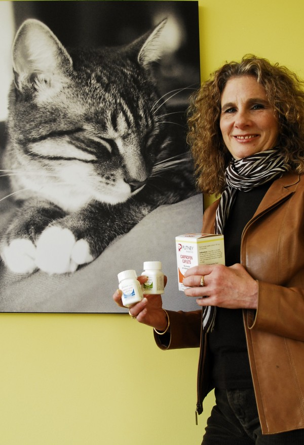 Jeanne Hoffman, chairman, president and CEO of Putney Inc., holds samples of some of the generic medication the company offers to veterinarian practices on Feb. 3, 2012.